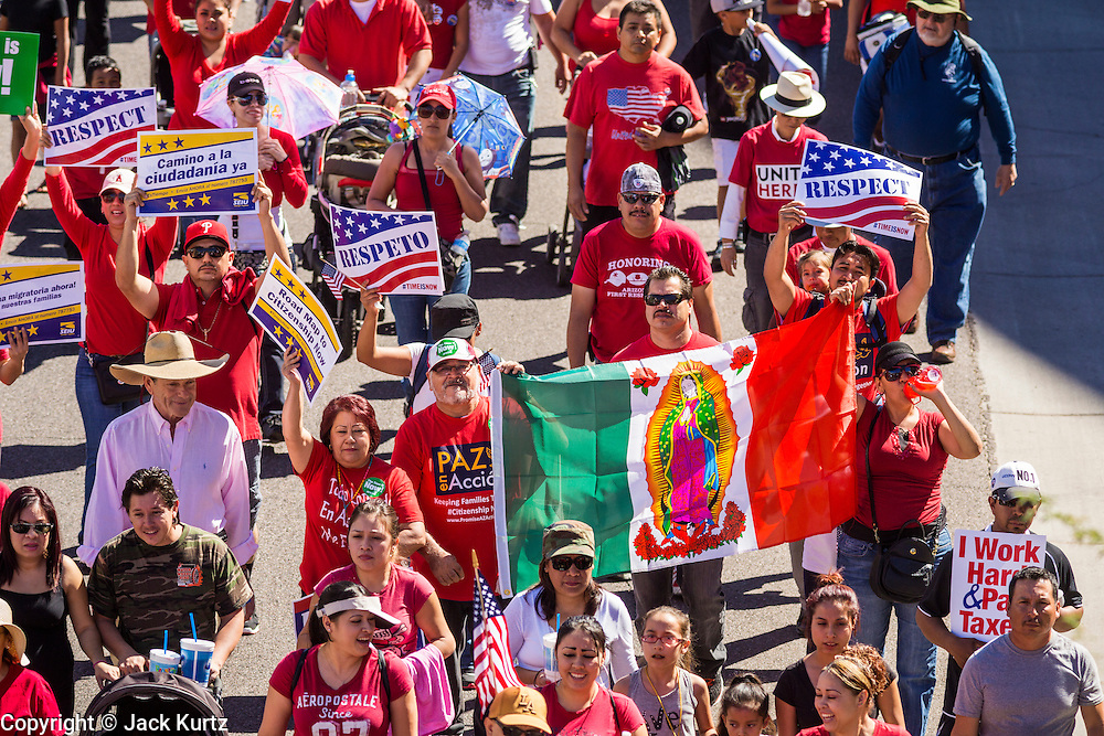 05 OCTOBER 2013 - PHOENIX, ARIZONA:  People march for immigration reform in Phoenix. More than 1,000 people marched through downtown Phoenix Saturday to demonstrate for the DREAM Act and immigration reform. It was a part of the National Day of Dignity and Respect organized by the Action Network.   PHOTO BY JACK KURTZ