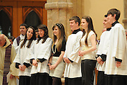 Catholic high school students that helped plan a mass at Holy Name Cathedral to promote service leadership in the church are congratulated for their efforts by fellow students and school staff.