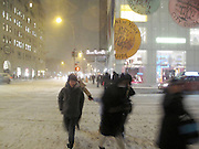 19 December 2009 New York, NY- Atmosphere at West 57th & 5th Ave during the first major snowstorm of the Winter Season dropping up to 24inches in New York City area leaving shoppers and residents gripping with snowstorm. Photo Credit: Terrence Jennings/SIPA USA