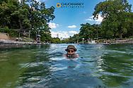 Swimming at Barton Springs Pool in Austin, Texas, USA MR