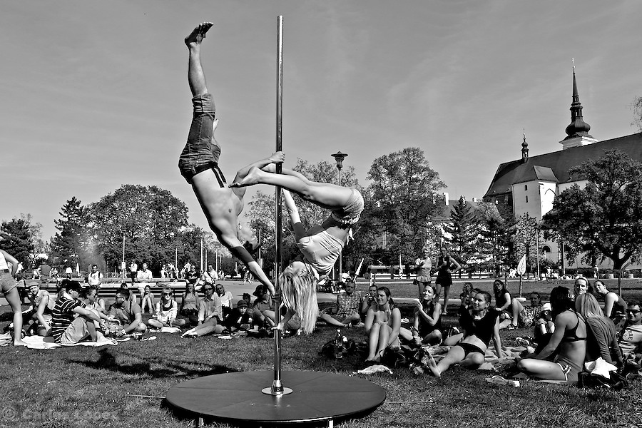 People gathering to see a public demostration of Pole dance, in the square Moravske Namesti in the city of Brno..The event was organized byt the local pole dance school Decadance.