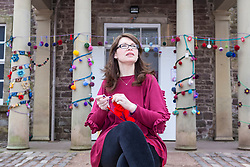 Yarn Bombing during the Scotland-wide World Heritage Day festivities. Six unique events, coordinated by Dig It! 2017, celebrated Scotland's six World Heritage Sites as part of the 2017 Year of History, Heritage and Archaeology. <br /> <br /> Pictured: Volunteer Lee Maclean crocheting outside the New Lanark Institute