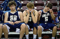 JEROME A. POLLOS/Press..Lake City High's Wes Beusan, left, Brady Smith and Chris Wheelock wait for the final minutes to run down of their 72-52 loss to Rocky Mountain High Friday at the state 5A boys basketball tournament at Idaho Center in Nampa.