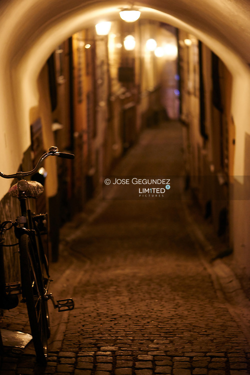 Bicycle parked on lonely Alley in the old town in the night