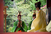 """Yaotome"" dancers take part in a ritual during the annual Reitaisai Grand Festival at Tsurugaoka Hachimangu Shrine in Kamakura, Japan on  14 Sept. 2012.  Sept 14 marks the first day of the 3-day Reitaisai festival, which starts early in the morning when shrine priests and officials perform a purification ritual in the ocean during a rite known as hamaorisai and limaxes with a display of yabusame horseback archery. Photographer: Robert Gilhooly"