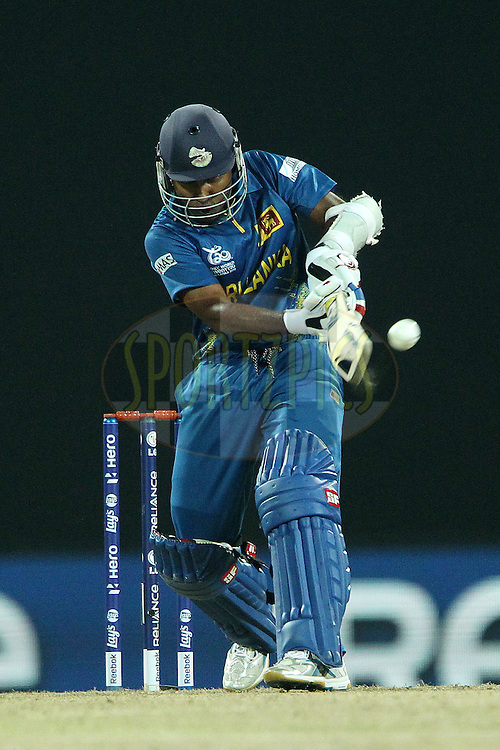 Mahela Jayawardene pulls a delivery from Jade Dernbach of England for six during the ICC World Twenty20 Super Eights match between England and Sri Lanka held at the  Pallekele Stadium in Kandy, Sri Lanka on the 1st October 2012..Photo by Ron Gaunt/SPORTZPICS