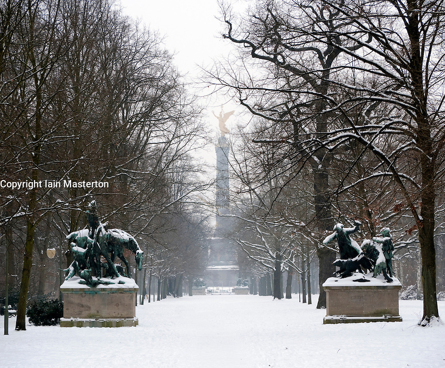 Snow covered parkland and Siegessäule in Tiergarten Park in central Berlin in winter 2010