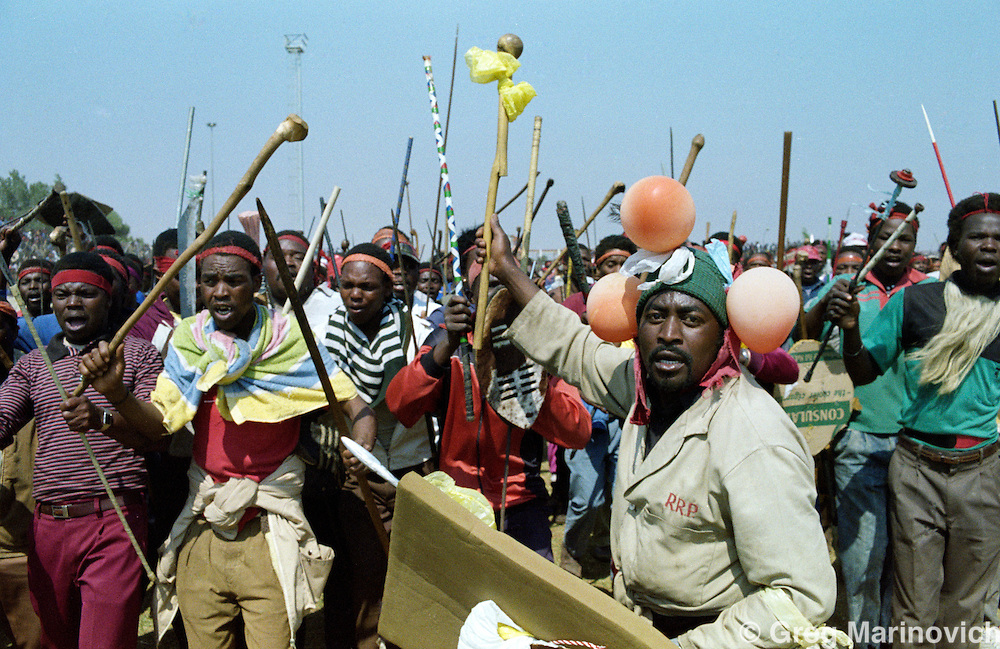 Inkatha Freedom Party supporters march down Khumalo street, Thokoza, South Africa, 1990