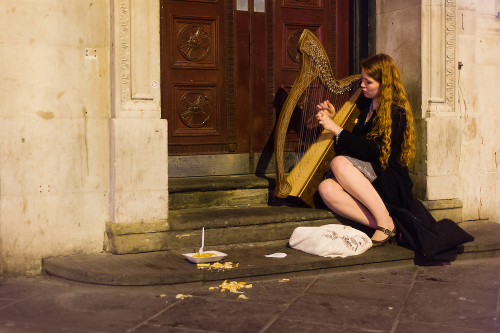 A woman plays the harp on St Patricks Day. Bold Street, Liverpool.