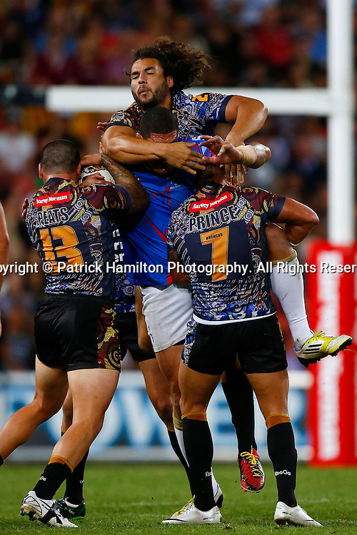Ryan James leaps high to assist Nathan Peats (l) and Scott Prince ® to smother Willie Mason during the NRL All Stars game at Suncorp Stadium, Brisbane on February 09, 2013.