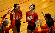1 Nov. 2011 -- EDWARDSVILLE, Ill. -- Edwardsville High School girls' volleyball players Mackenzie Collins (8) and Sarah Parker (5) lead the cheers after the Tigers scored a point on Belleville West High School in the third game of the IHSA Class 4A girls volleyball sectional semifinal at Edwardsville High School in Edwardsville, Ill. Tuesday, Nov. 1, 2011. Edwardsville won, 2-1. Photo © copyright 2011 Sid Hastings.