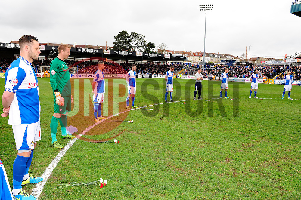 Bristol Rovers players' stand next to flowers to pay respect for the hillsborough disaster  - Photo mandatory by-line: Dougie Allward/JMP - Mobile: 07966 386802 12/04/2014 - SPORT - FOOTBALL - Bristol - Memorial Stadium - Bristol Rovers v Torquay United - Sky Bet League Two