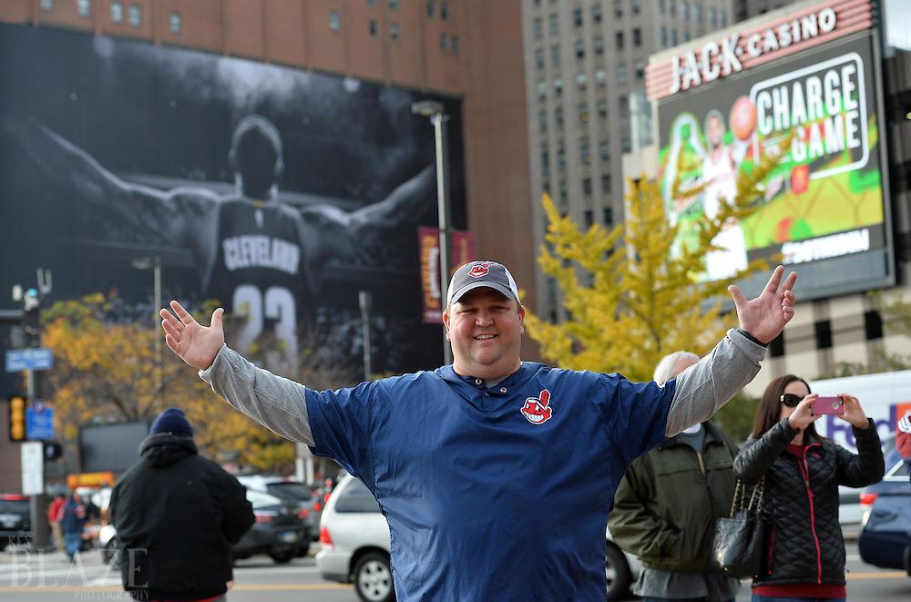 Oct 25, 2016; Cleveland, OH, USA; Cleveland Indians fan Brad Olecki poses for a photo in front of a mural of Cleveland Cavaliers player LeBron James before game one of the 2016 World Series against the Chicago Cubs at Progressive Field. Mandatory Credit: Ken Blaze-USA TODAY Sports