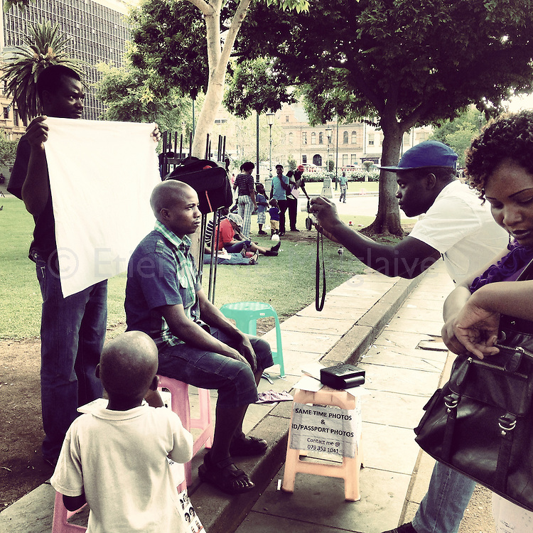 ID photo booth on the curb in Pretoria, January 2013.
