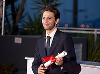 Director Xavier Dolan with the Grand Prix award for Juste La Fin Du Monde (It's Only The End Of The World), at the Palm D'Or Winners photocall at the 69th Cannes Film Festival Sunday 22nd May 2016, Cannes, France. Photography: Doreen Kennedy