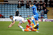Peterborough Utd's Daniel Lafferty (18) is foiled by Rochdale goalkeeper Josh Lillis and Rochdale defender Joe Rafferty (2) during the EFL Sky Bet League 1 match between Peterborough United and Rochdale at London Road, Peterborough, England on 12 January 2019.