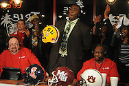 """Lafayette High quarterback Jeremy Liggins (center), with hosts Ronnie Williams (left) and Fred Johnson, says """"Go Tigers, baby"""" as he announces he will attend LSU during the Collier Dental Sports Roundup at the Irie in Oxford, Miss. on Monday, January 30, 2012."""