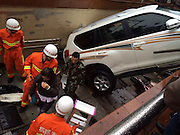 FUZHOU, CHINA - DECEMBER 09: (CHINA OUT)<br /> <br /> Woman Driver Mistakes Throttle As Brake <br /> <br />  A white Toyota hangs on stairs of a underground passage as the woman driver mistakes throttle as brake when reversing on December 9, 2015 in Fuzhou, Fujian Province of China. The car broke railings and then hung in air above stairs.<br /> ©Exclusivepix Media