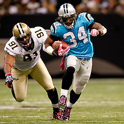 October 3, 2010; New Orleans, LA, USA; Carolina Panthers running back DeAngelo Williams (34) runs away from New Orleans Saints defensive end Will Smith (91) for a touchdown during a game at the Louisiana Superdome. The Saints defeated the Panthers 16-14. Mandatory Credit: Derick E. Hingle