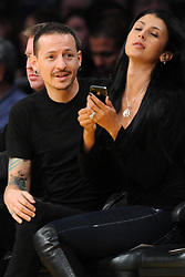 ©2011 GAMEPIKS 310-828-3445<br /> <br /> Linkin Park lead singer Chester Bennington and his wife Talinda Bentley sits courtside as he attends the Los Angeles Lakers/Portland Trail Blazers NBA game at Staples Center in Los Angeles on March 20, 2011. The Lakers defeated the Blazers 84-80.<br /> <br /> XYZ (Mega Agency TagID: MEGAR32159_9.jpg) [Photo via Mega Agency]