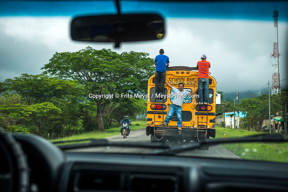 Matagalpa, Nicaragua, May 2014. passengers ride an old schoolbus on the outside. Matagalpa tours offers trips to coffee plantations and remote villages, rural community tourism, agro-tourism, hiking and biking. Central America's largest and least populated country consists of lakes; volcanoes and Spanish colonial cities. Photo by Frits Meyst / MeystPhoto.com
