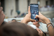 June 28, 2017 : Taking a picture with a smartphone of Pope Francis as leaves at the end of the weekly general audience in Saint Peter's square at the Vatican.  Antoine Mekary | Aleteia | I.Media