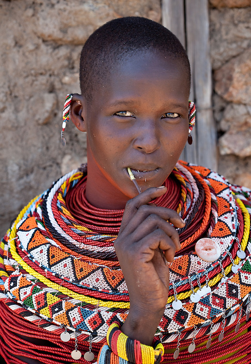 Samburu woman cleaning teeth with a branch from a native tree