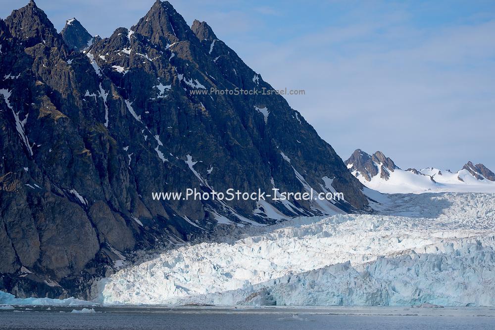 Glacier alongside rocks in the North Sea of Norway