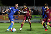 AFC Wimbledon midfielder Mitchell (Mitch) Pinnock (11) with a shot on goal during the EFL Sky Bet League 1 match between AFC Wimbledon and Bradford City at the Cherry Red Records Stadium, Kingston, England on 2 October 2018.