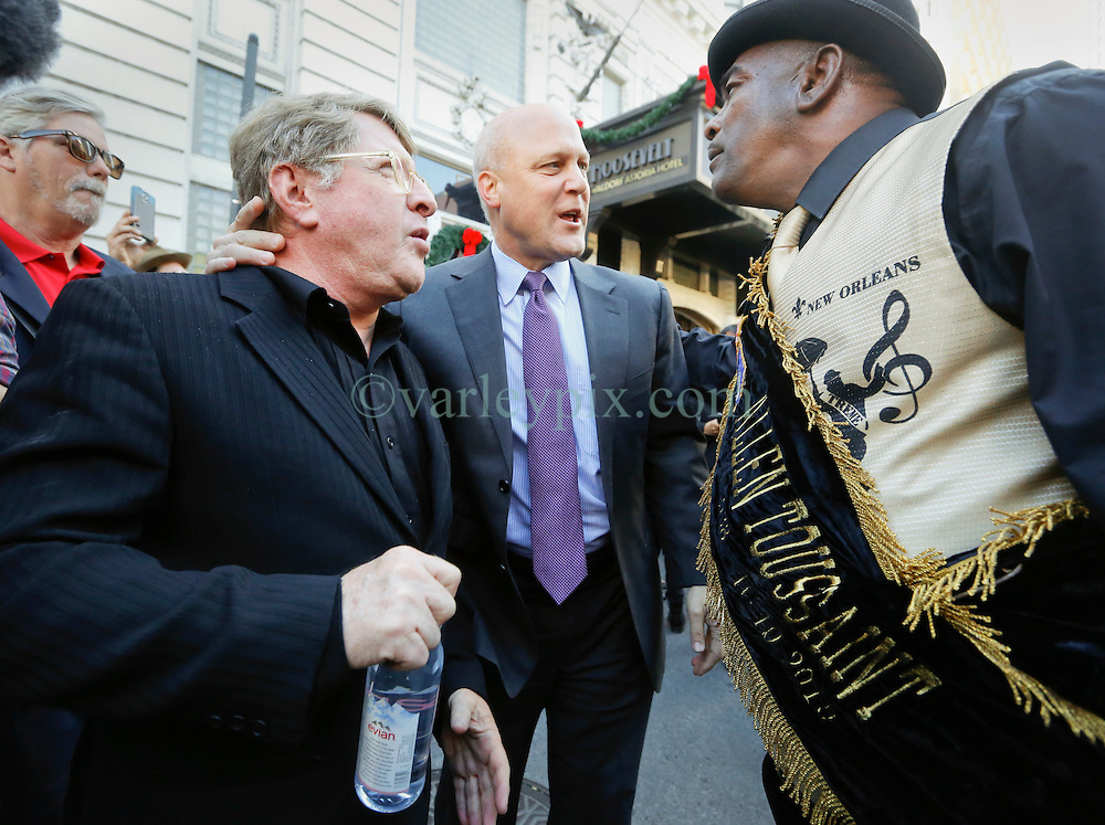 20 November 2015. Orpheum Theater, New Orleans, Louisiana. <br /> Memorial service for musician Allen Toussaint. <br /> Quint Davis and mayor Mitch Landrieu at the second line parade following the service.<br /> Photo; Charlie Varley/varleypix.com