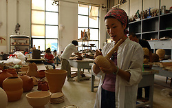 BEIJING, CHINA - JUNE-6-2005 - Students work in the ceramics studio at the Department of Sculpture at the Central Academy of Fine Arts in Beijing. (PHOTO © JOCK FISTICK)
