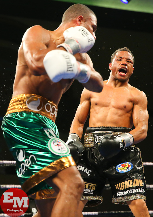 Atlantic City, New Jersey, USA - March 29, 2014: Thomas Dulorme (green trunks) and Karim Mayfield (black trunks) during their 10 round light welterweight bout at the Adrian Phillips Ballroom in Atlantic City, NJ.  Photo: Ed Mulholland/HBO