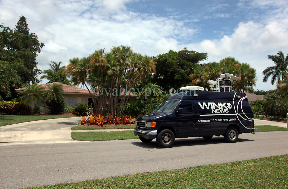 30 July 2015. Marco Island, Florida.<br /> A news truck passes by the deserted Florida home of Dr Walter Palmer, the Minnesota dentist who allegedly killed Cecil the lion in Zimbabwe. Dr Palmer has gone to ground since the story broke, taking him from hunter to hunted.<br /> Photo; Charlie Varley/varleypix.com