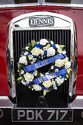 © Licensed to London News Pictures . 02/09/2013 . Bury , UK . A Blue Watch wreath mounted to the grille of a vintage fire truck , used to carry Stephen Hunt's coffin to the church . The funeral of fireman Stephen Hunt at Bury Parish Church today (Tuesday 3rd September 2013) . Stephen Hunt died whilst tackling a blaze at Paul's Hair World in Manchester City Centre in July 2013 . Photo credit : Joel Goodman/LNP