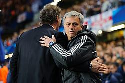 Chelsea Manager Jose Mourinho (POR) hugs PSG Manager Laurent Blanc (FRA) before kick off - Photo mandatory by-line: Rogan Thomson/JMP - 07966 386802 - 08/04/2014 - SPORT - FOOTBALL - Stamford Bridge, London - Chelsea v Paris Saint-Germain - UEFA Champions League Quarter-Final Second Leg.