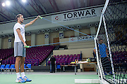 Jerzy Janowicz of Poland warm up before training session four days before the BNP Paribas Davis Cup 2014 between Poland and Croatia at Torwar Hall in Warsaw on March 31, 2014.<br /> <br /> Poland, Warsaw, March 31, 2014<br /> <br /> Picture also available in RAW (NEF) or TIFF format on special request.<br /> <br /> For editorial use only. Any commercial or promotional use requires permission.<br /> <br /> Photo by &copy; Adam Nurkiewicz / Mediasport