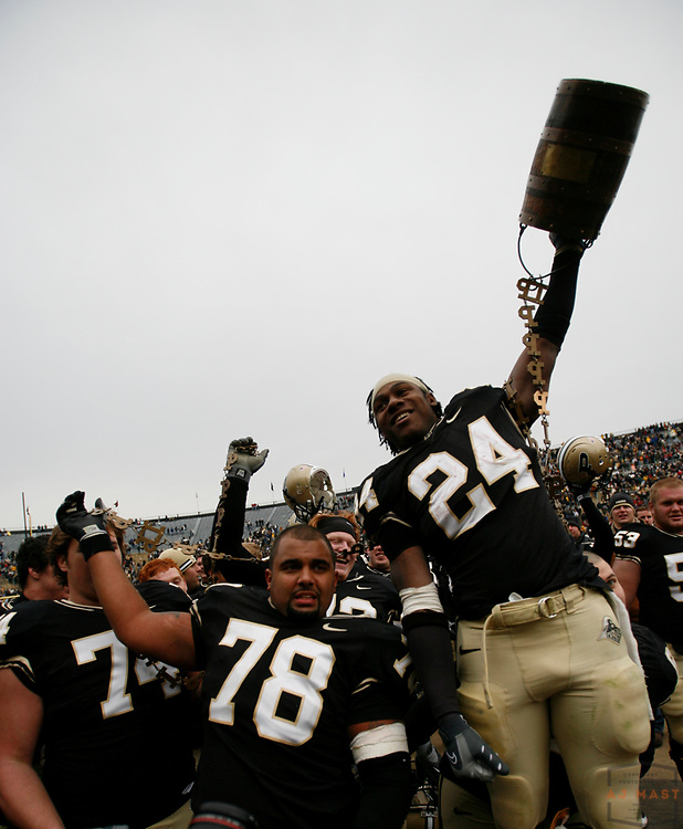 22 November 2008: Purdue center Cory Benton (78) and Purdue running back Kory Sheets (24) with the Old Oaken Bucket after the Indiana Hoosiers played the Purdue Boilermakers in a college football game in West Lafayette, Ind....