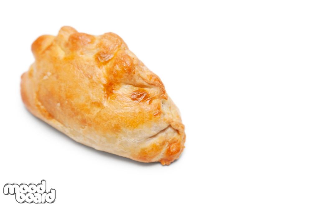 Fresh Cornish pastry over white background