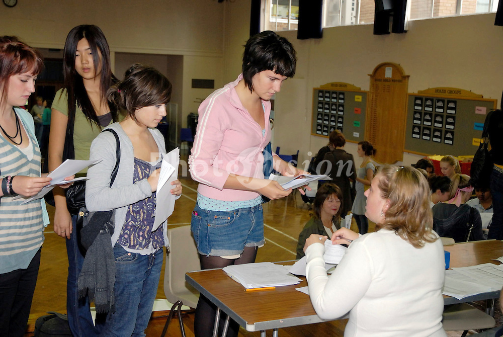 Secondary pupils getting their GCSE results at school UK