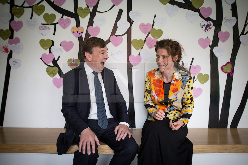 © Licensed to London News Pictures . 17/07/2015 . Manchester , UK . JOHN WHITTINGDALE OBE , MP for Maldon and Secretary of State for Culture Media and Sport , talking to ESME WARD (correct) , Head of Learning and Engagement at Whitworth Art Gallery , in front of a wall of visitors' messages during a visit to the newly extended and refurbished Whitworth Art Gallery , in Manchester . The venue has been  nominated for this year's (2015) Riba Stirling Prize for the UK's best new building . Photo credit: Joel Goodman/LNP