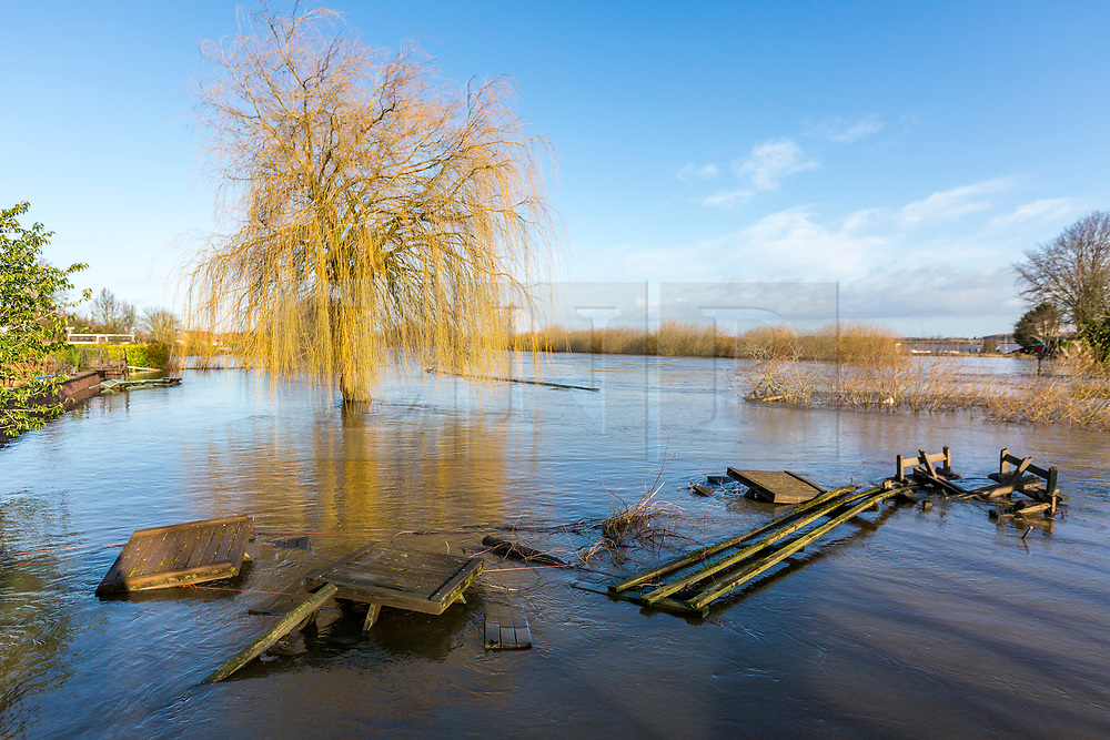 © Licensed to London News Pictures. 12/02/2020. Cawood UK. Pub garden furniture in flood water after the River Ouse in Cawood, Yorkshire broke its banks after recent heavy rainfall with fears of further flooding this weekend. Photo credit: Andrew McCaren/LNP