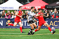 Gareth O&rsquo;Brien of Toronto Wolfpack  and Jay Pitts (R) of London Broncos chase the ball during the Super 8s Qualifiers Million Pound Game at Lamport Stadium, Toronto, Canada<br /> Picture by Stephen Gaunt/Focus Images Ltd +447904 833202<br /> 07/10/2018
