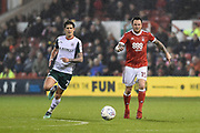 Barnsley's Connor Mahoney (21) and Nottingham Forest forward Lee Tomlin (15) during the EFL Sky Bet Championship match between Nottingham Forest and Barnsley at the City Ground, Nottingham, England on 24 April 2018. Picture by Jon Hobley.