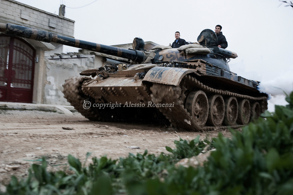 SYRIA - Homs province: Free Syrian Army fighters drive a tank whose crew defected from government forces  on Monday in Homs province, on February 22, 2012. ALESSIO ROMENZI
