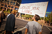 "22 OCTOBER 2011 - PHOENIX, AZ:    Occupy Phoenix protesters in Cesar Chavez Plaza in Phoenix. The demonstrations at Occupy Phoenix, AZ, entered their second week Saturday. About 50 people are staying in Cesar Chavez Plaza, in the heart of downtown. The crowd grows in the evening and on weekends. Protesters have coordinated their actions with police and have gotten permission from the city to set up shade shelters and sleep in the park, but without tents or sleeping bags, which is considered ""urban camping,"" instead protesters are sleeping on the sidewalk.  PHOTO BY JACK KURTZ"