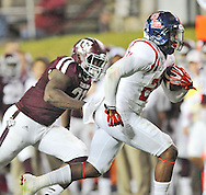 Mississippi Rebels linebacker Keith Lewis (24) runs back a fumble recovery back for a touchdown against Texas A&M Aggies running back Tra Carson (21) in College Station, Texas on Saturday, October 11, 2014. Ole Miss won 35-20 to improve to 6-0.