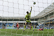 Swindon Town goalkeeper Tyrell Belford (25)  saves from Coventry City forward Darius Henderson (44)  last minute shot on goal during the Sky Bet League 1 match between Coventry City and Swindon Town at the Ricoh Arena, Coventry, England on 19 March 2016. Photo by Simon Davies.
