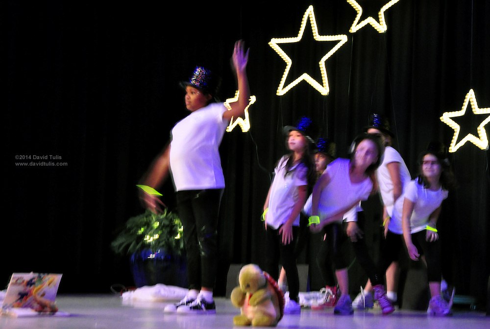 """Fireflies"" including Mackenzie Fields, Liza Fitzgerald, April Clark, Bailey Hewitt, Autumn McAllister and Lily Massey perform their routine at the Sagamore Hills Elementary School Talent Night event in Atlanta on Friday Oct. 22, 2010. This photo was made by second grader Lauren E. Tulis. (Lauren Tulis/Staff/laurentulis@clear.net)"