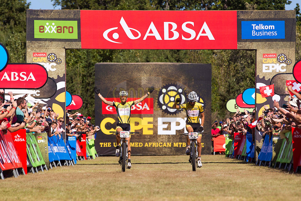 Overall Winners Christoph Sauser(Switzerland) of Burry Stander-Songo  and Jaroslav Kulharvy(Czech Republic) of Burry Stander-Songo during the final stage (stage 7) of the 2013 Absa Cape Epic Mountain Bike stage race from Stellenbosch to Lourensford Wine Estate in Somerset West, South Africa on the 24 March 2013..Photo by Nick Muzik/Cape Epic/SPORTZPICS