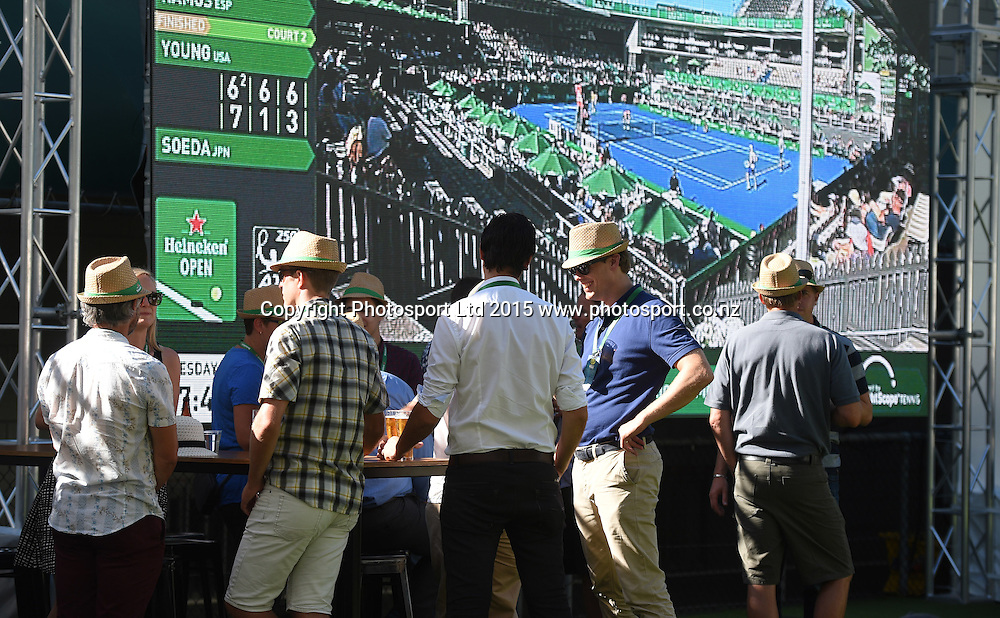 Tennis fans enjoy the Heineken Baseline hospitality area on Day 2 at the Heineken Open. Festival of Tennis, ATP World Tour. ASB Tennis Centre, Auckland, New Zealand. Tuesday 13 January 2015. Copyright photo: Andrew Cornaga/www.photosport.co.nz